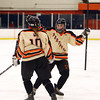Beverly sophomore Anna Hayden (2), right, greets senior captain Rachel Trocchi (10) after she scored a second period goal against Hingham to put Beverly up 2-1.DAVID LE/Staff Photo 3/1/14