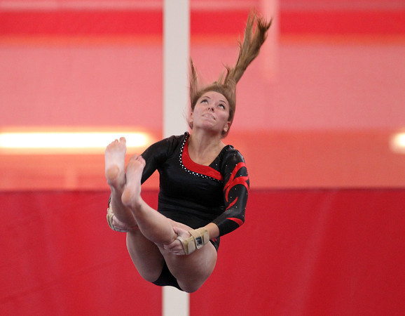 Masco gymnast Jessica DeMarco concentrates while flipping over during the vault in the North Sectional Tournament held at Hudson High School on Saturday. DAVID LE/Staff Photo 2/22/14