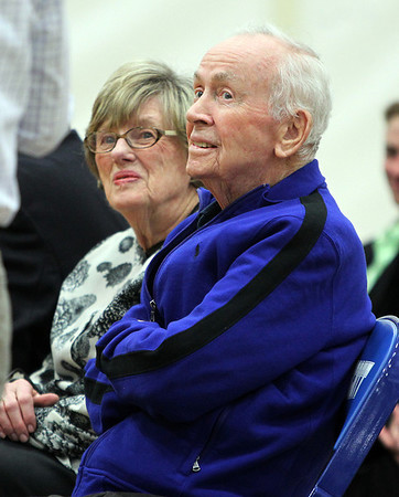 Legendary Swampscott High School coach and athletic director Dick Lynch, and his wife Joanne, listen to speakers during the dedication of Swampscott High School's new gymnasium in Lynch's honor. DAVID LE/Staff photo