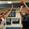 Pingree senior captain Kyle Lentini (22) drains a three pointer before Providence Country Day's Justin LaRose (24) can reach him. DAVID LE/Staff Photo 2/26/14