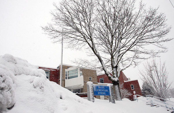 Large piles of snow surrounded the entrance of Bates Elementary School in Salem on Tuesday afternoon. DAVID LE/Staff Photo