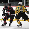 Marblehead sophomore centerman Matt Koopman (7) dekes around North Reading senior captain Jake Laroche (28) and drives to the net. Koopman registered a goal to help the Headers to a 4-1 win over the Hornets in the D2 North Quarter Finals at Stoneham Arena in Stoneham on Friday evening. DAVID LE/Staff Photo 2/28/14