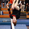 Masco gymnast Caitlin Clarizia flips head over heels while performing her dismount on the beam during the North Sectional Tournament held at Hudson High School on Saturday. DAVID LE/Staff Photo 2/21/14