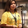 Higgins Middle Schooler Andeemae Sims spells a word during the 4th Annual Peabody Higgins Middle School Spelling Bee at the Northshore Mall on Wednesday evening. DAVID LE/Staff Photo 2/12/14