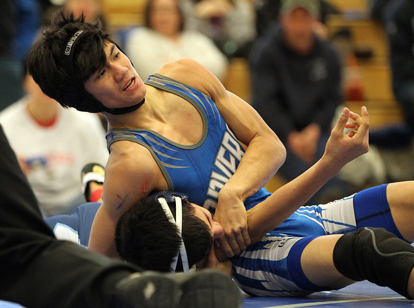 Danvers wrestler Michael Neff tries to pin his Wilmington opponent Fox Maxwell during the D3 North Wrestling State Meet at Danvers High School on Saturday morning. DAVID LE/Staff photo