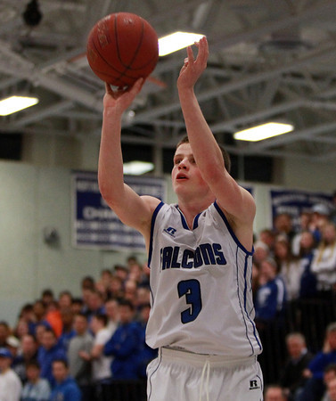 Danvers senior captain Mark McCarthy (3) drains a three-pointer against Marblehead on Wednesday evening. DAVID LE/Staff Photo 2/26/14