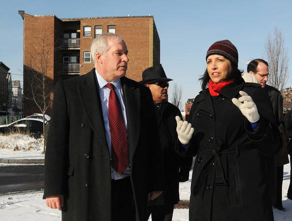 Ken Yuszkus/Staff photo: Salem:  Federal Reserve Bank president Eric Rosengren listens to Salem Mayor Kim Driscoll during a walking tour of the Point neighborhood Tuesday morning. They are at the corner of Peabody, Ward, and Congress Streets.