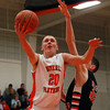 Beverly sophomore guard Sam Traicoff (20) scoops a shot up and off the back board against North Andover on Tuesday evening. DAVID LE/Staff photo 2/25/14