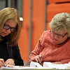 Georgina Keefe-Feldman, left, and Fran Macdonald, of the Beverly BOard of Registrars, tally up the final numbers for the Saturday vote on the proposed Brimbal Ave Project in Beverly. DAVID LE/Staff photo