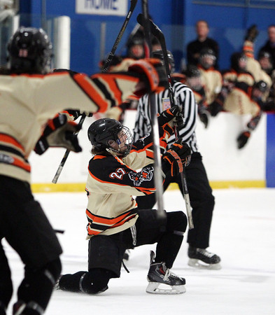 Beverly senior captain Connor Irving (22) drops to a knee to celebrate his first period goal against Danvers on Friday evening. DAVID LE/Staff Photo 2/28/14