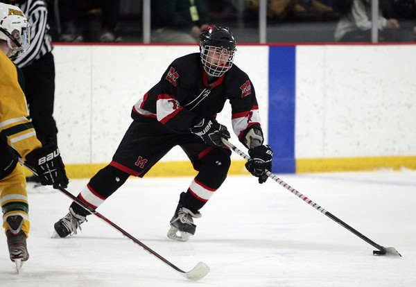 Marblehead sophomore centerman Matt Koopman (7) dangles with the puck against North Reading on Friday evening. DAVID LE/Staff Photo 2/28/14