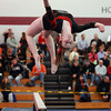 Masco gymnast Erica Richard flips over backwards while dismounting from her beam routine during the North Sectional Tournament held at Hudson High School on Saturday. DAVID LE/Staff Photo 2/21/14