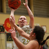 Bishop Fenwick sophomore Colleen Corcoran (24) hits a jumper against Gloucester on Thursday evening. DAVID LE/Staff photo