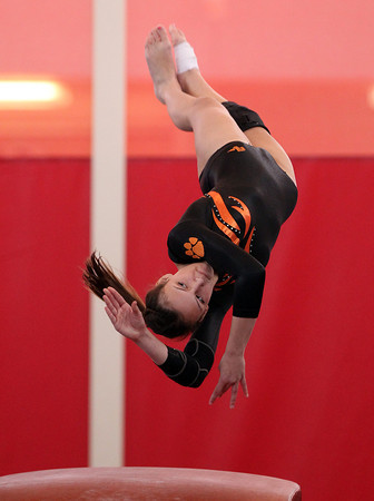 Beverly gymnast Kaitlyn O'Connor twists and flips after launching herself off the vault during the North Sectional Tournament held at Hudson High School on Saturday. DAVID LE/Staff Photo 2/22/14