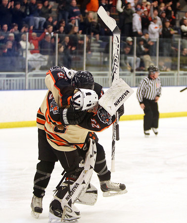 Beverly junior Caitlin McBride (20) tackles goalie Madison Jalbert (25) to the ground in celebration after the Panthers defeated Hingham 3-2 in the D1 first round on Saturday afternoon. DAVID LE/Staff Photo 3/1/14