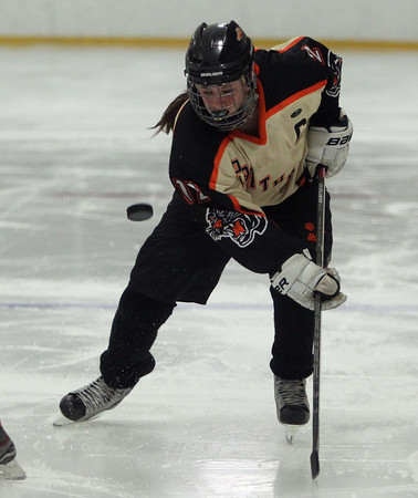 Beverly senior captain Nicole Kamens (12) keeps her eyes on the puck in the offensive zone against Austin Prep on Wednesday evening. DAVID LE/Staff photo 3/5/14