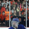 The Beverly fan section reacts to a play in the Panthers defensive zone during the second period of overtime on Friday evening in the D2 North Quarter Finals at Stoneham Arena in Stoneham. DAVID LE/Staff Photo 2/28/14