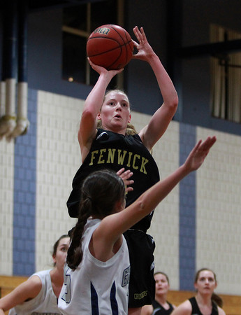 Bishop Fenwick sophomore Colleen Corcoran (24) takes a jumper against Hamilton-Wenham in the championship game of the General Patton Tournament on Tuesday evening. DAVID LE/Staff Photo 2/18/14
