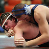 Beverly: Gloucester wrestler Tom Donahue, left, tries to escape the grasp of Peabody's Gio Jannino, right, during their 195-lb match during the NEC/CAL Tournament at Beverly High School on Saturday morning. DAVID LE/Staff Photo