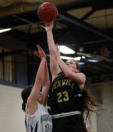 Bishop Fenwick senior captain Gianna Pizzano (23) takes a jump shot over Hamilton-Wenham senior captain Suzanne Rose (15) on Tuesday evening. DAVID LE/Staff Photo 2/18/14