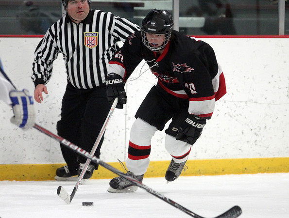 Salem freshman forward Cam Twomey (10) carries the puck up-ice against Dracut on Thursday evening. DAVID LE/Staff Photo 2/27/14