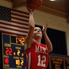 Masco senior captain Hannah Kiernan (12) drives in for an easy layup against Lynn English during the St. Mary's Spartan Classic on Monday evening at St. Mary's High School in Lynn. DAVID LE/Staff Photo 2/17/14