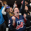 Ken Yuszkus/Staff photo:  Danvers: Katelyn Dugan, in front, sister of Megan who is the captain of the USA womens hockey team, cheers and the crowd reacts to the fist goal of the game scored by Megan.