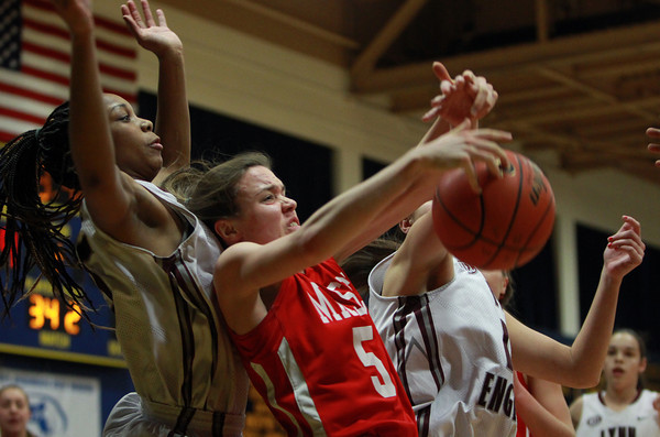 Masco junior Meghan Collins (5) grabs an offensive rebound away from Lynn English senior Makayla Everette (5) during the St. Mary's Spartan Classic on Monday evening at St. Mary's High School in Lynn. DAVID LE/Staff Photo 2/17/14