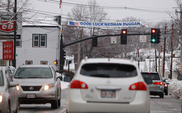A banner hanging across Maple St. in downtown Danvers wishes Danvers native and Olympian Megan Duggan good luck as she prepares to take on Canada in the Gold Medal Women's Hockey game on Thursda.y DAVID LE/Staff Photo 2/19/14
