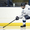 Peabody senior captain Andrew Bisconti controls the puck against Beverly in the 27th Annual Carlin Cup on Monday afternoon. DAVID LE/Staff Photo 2/17/14