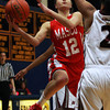 Masco senior guard Hannah Kiernan (12) drives hard to the basket against Lynn English during the St. Mary's Spartan Classic on Monday evening at St. Mary's High School in Lynn. DAVID LE/Staff Photo 2/17/14