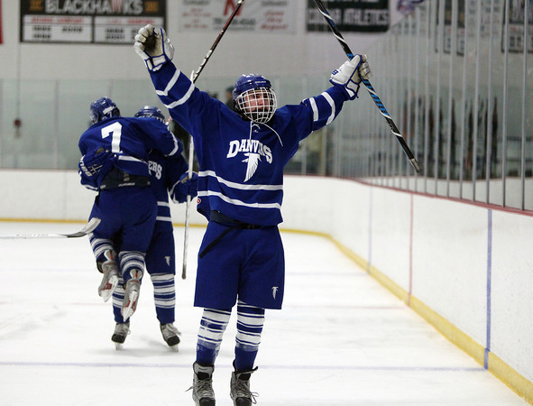 Danvers junior forward Kyle Cahill (13) celebrates his first period goal against Beverly with the Danvers fans on Friday evening. DAVID LE/Staff Photo 2/28/14