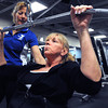 Ken Yuszkus/Staff photo: Beverly:  Personal trainor Lee Benton, left, works with Karen DiMillio of Beverly on the exercise equipment at the Sterling YMCA. Karen attended the open house held at the YMCA earlier Monday morning.
