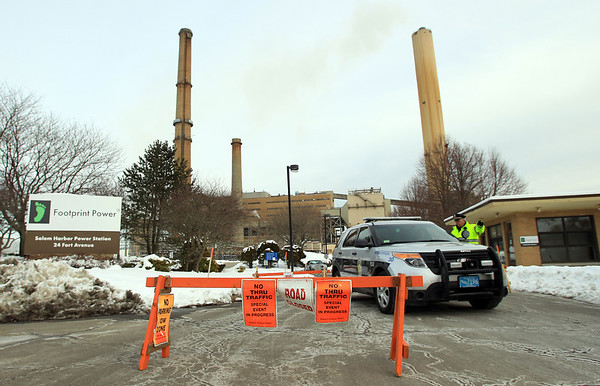 The Salem Police Department blocked off the endurance to the Salem Power Plant and had a strong presence along Fort Ave as protestors and supporters of the proposed natural gas facility demonstrated on Saturday afternoon. DAVID LE/Staff photo
