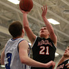 Marblehead junior forward Will Millett (21) takes a jumper against Danvers on Wednesday evening. DAVID LE/Staff Photo 2/26/14