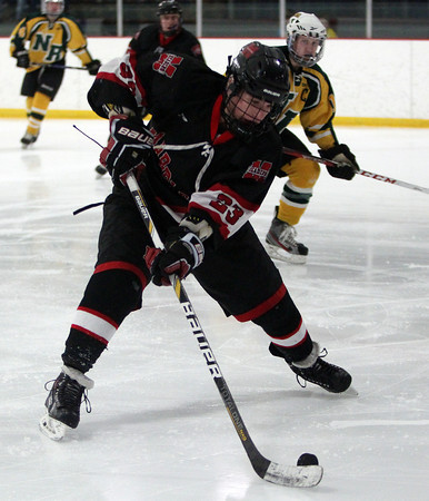 Marblehead freshman forward Braden Haley (23) makes a backhanded centering pass against North Reading on Friday evening in the D2 North Quarter Finals at Stoneham Arena in Stoneham. DAVID LE/Staff Photo 2/28/14