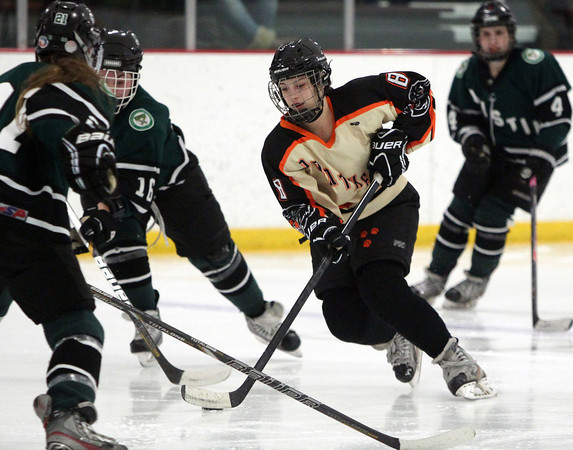 Beverly eighth grader Marlee Hamor (8) weaves her way through the offensive zone against Austin Prep on Wednesday evening during the D1 State quarterfinal. DAVID LE/Staff photo 3/5/14