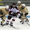 Marblehead sophomore forward Matt Koopman (7) keeps control of the puck while being leaned on by Haverhill junior Jon Langlois (2) and sophomore Kyle Gosselin (19) on Tuesday evening. DAVID LE/Staff photo 2/25/14