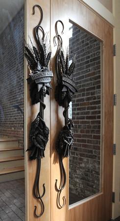 Ken Yuszkus/Staff photo: Ipswich:  Custom made handles adorn the doors at Ipswich Ale Brewery's new building in Ipswich.  2/18/14