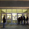 Anxious Beverly residents crowd around the doors at Beverly High School to get a look at the final voting numbers regarding the proposed Brimbal Ave Project on Saturday evening. DAVID LE/Staff photo