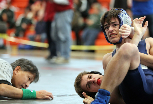 Beverly: Marblehead/Swampscott wrestler Colin Vetysman, left, tries to keep his shoulder off the mat as Peabody's Riley Driscoll tries to pin him during the NEC/CAL Tournament at Beverly High School on Saturday morning. DAVID LE/Staff Photo