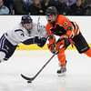 Beverly junior forward Jesse McLaughlin (15) tries to keep control of the puck while being checked hard by Peabody junior defenseman Matt Pino (7) during the third period of play on Monday afternoon. DAVID LE/Staff Photo 2/17/14