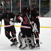 Marblehead junior defenseman Bryan Cohn (3) and senior forward Colby Shepard (10) celebrate the Headers 4-1 with senior goalie Myles Barry (35). DAVID LE/Staff Photo 2/28/14
