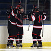 Marblehead sophomore Tom Koopman, center, celebrates his second period goal with teammates Kyle Koopman (14) and Braden Haley (23) on Wednesday evening. DAVID LE/Staff Photo 2/12/14