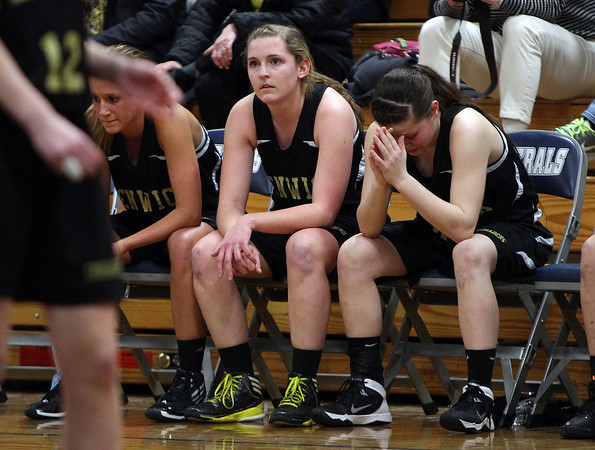 Bishop Fenwick senior captains Kate Lipka, Bridget Corcoran, and Gianna Pizzano can barely watch as time ticks down in the Crusaders' loss against St. Mary's in the D3 North semifinals at Hamilton-Wenham Regional High School on Tuesday evening. DAVID LE/Staff photo