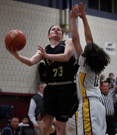 Bishp Fenwick senior captain Gianna Pizzano (23) drives to the hoop while being defended by St. Mary's Briana Randolph (12) during the first half of play in the D3 North semifinal at Hamilton-Wenham Regional High School on Tuesday evenin. DAVID LE/Staff photo