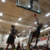 Salem senior forward Rashad Keys (1) manages to convert a layup while being hassled by Lynn Classical junior Kyle Doucette (15) during the second half of play on Friday evening. DAVID LE/Staff Photo 2/14/14