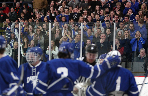 The Danvers fan section loudly cheers for Falcons junior goalie Alex Taylor (1) after he made another one of his 41 saves on Friday evening against Beverly in the D2 North Quarter Finals. DAVID LE/Staff Photo 2/28/14