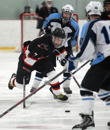 Salem senior forward Danny Heck (7) skates hard and chases down a loose puck against Dracut on Thursday evening. DAVID LE/Staff Photo 2/27/14