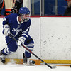 Danvers junior forward Sean Lundergan (2) tries to corral the puck against Beverly on Friday evening in the D2 North Quarter Finals at Stoneham Arena in Stoneham. DAVID LE/Staff Photo 2/28/14